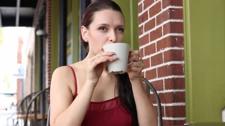 centrum : Attractive young European woman drinking coffee at cafe