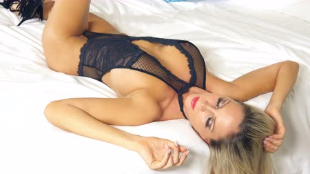 Sexy blonde lingerie girl on bed Stock Footage