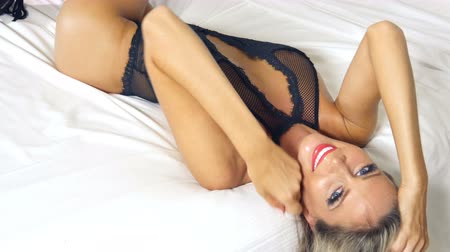 Sexy black lingerie woman on bed flirting Stock Footage