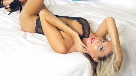 Sexy blonde lingerie girl on bed Stok Video