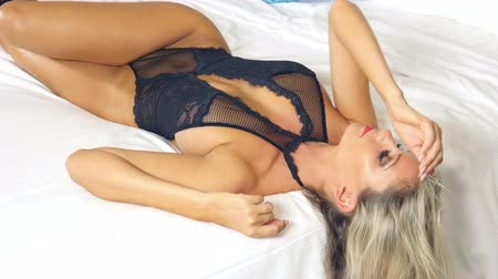 Sexy black lingerie girl on bed relaxing