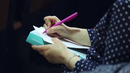 synopsis : Close up of a woman writer hand writing in a notebook