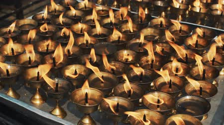 bhutan : burning prayer oil lamps in a Buddhist temple Stock Footage