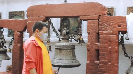 prayer flag : KATHMANDU, NEPAL - MARCH 22, 2018: Prayer bell in Budhanath