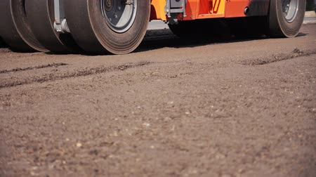 paving : roller asphalt for road repair. construction of a new motorway