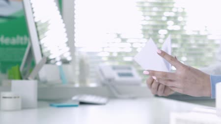 consulting : Patient at the pharmacy, he is giving a prescription to the pharmacist