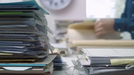 dosyalama : Employee working in the office with files and paperwork, business administration and management concept