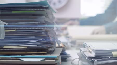 adminisztratív : Employee working in the office with files and paperwork, business administration and management concept