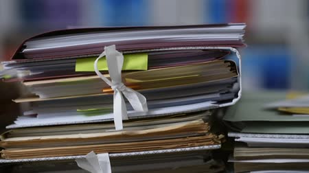 empilhamento : Office workers adding files on paperwork: workload and management concept