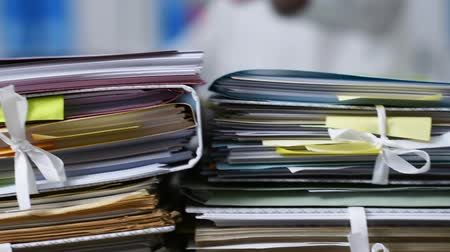 adminisztratív : Office workers adding files on paperwork: workload and management concept