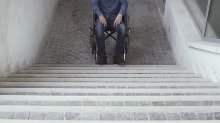 paraplegic : Woman pushing a wheelchair and inaccessible stairs: handicap and architectural barriers concept