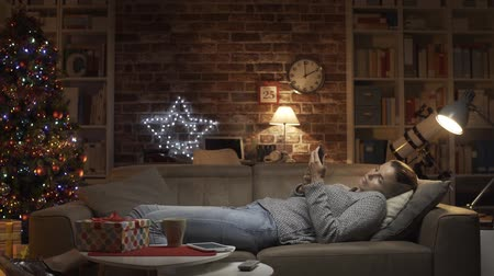 hale : Sad woman having a lonely Christmas She is disappointed and waiting for text messages her late phone, video montage Stok Video