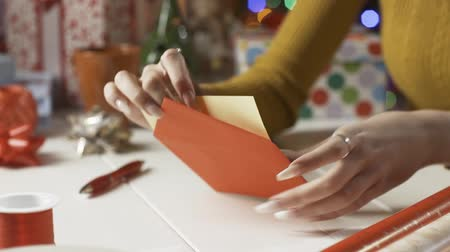 wrapping paper : Woman putting a Christmas card into an envelope, holidays and celebrations concept