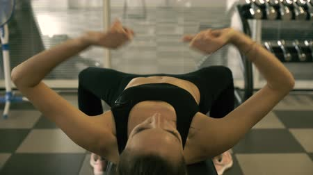 contra : Young fit woman doing her workout routine at the gym: fitness, sports and determination concept, video montage Stock Footage