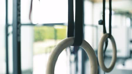 Hanging gymnastic rings at the gym, sports and gymnastics concept Stock Footage