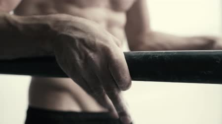 Muscular athletic man working out at the gym on dip bars, fitness and bodybuilding concept, video montage Stock Footage