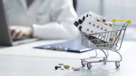 Shopping cart with the doctors desk, the doctor is working with a laptop in the background: