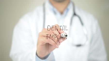 fenda : Dental Implant , Doctor writing on transparent screen