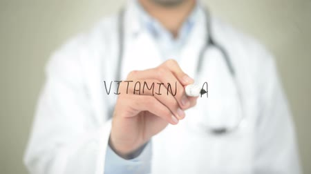 morele : Vitamin A , Doctor writing on transparent screen