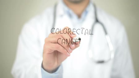 adomány : Colorectal Cancer , Doctor writing on transparent screen