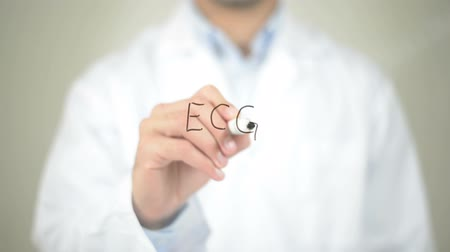 cardiological : ECG  , Doctor writing on transparent screen