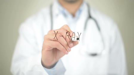 boné : X-Ray, Doctor writing on transparent screen Stock Footage