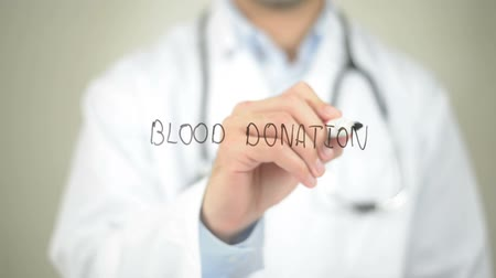 rh : Blood Donation, Doctor writing on transparent screen