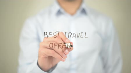 бразильский : Best Travel Offers, Man writing on transparent screen Стоковые видеозаписи