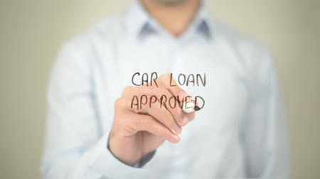 loans : Car Loan Approved, Man writing on transparent screen