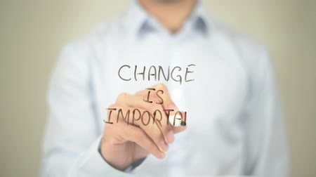importante : Change is Important, Man writing on transparent screen Stock Footage
