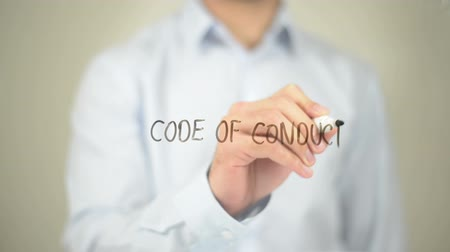 Code of Conduct, Man writing on transparent screen Стоковые видеозаписи