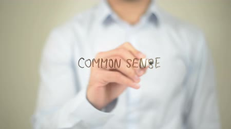 common : Common Sense, Man writing on transparent screen