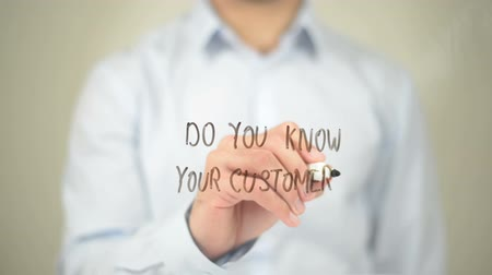 clientes : Do You Know Your Customers, Man writing on transparent screen