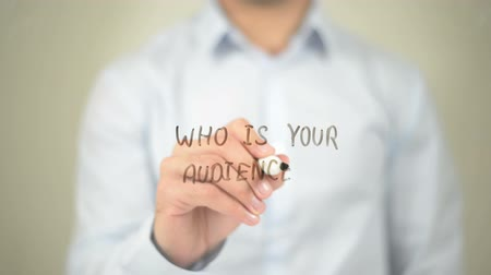 direkt : Who is Your Audience, Man Writing on Transparent Screen