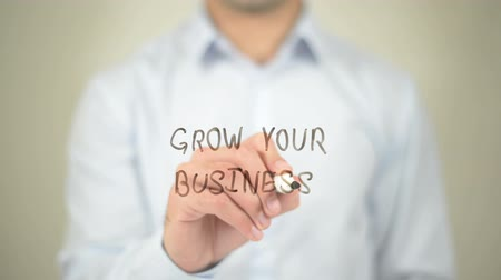 növekvő : Grow Your Business, Man writing on transparent screen