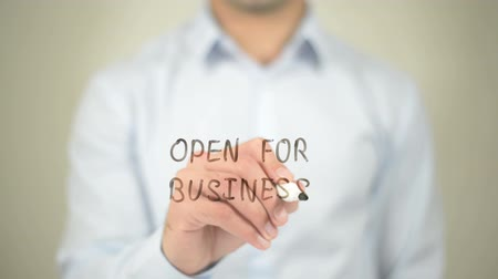 welcome sign : Open for Business, Man writing on transparent screen