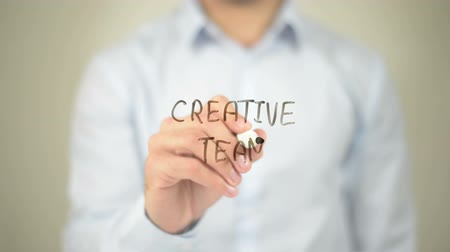 colega de trabalho : Creative Team, Man writing on transparent screen