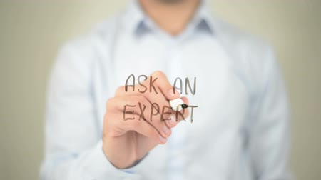 excelência : Ask an Expert, Man writing on transparent screen
