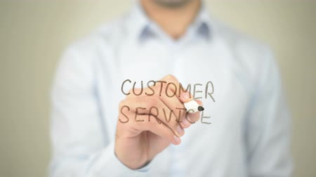 relação : Customer Service, Man writing on transparent screen Stock Footage