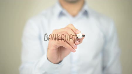 falido : Bankruptcy, Man writing on transparent screen Stock Footage