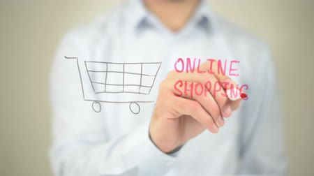 pisos : Online Shopping, Man writing on transparent screen Stock Footage