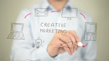 marketing : Creative Marketing, Man writing on transparent screen Stock Footage