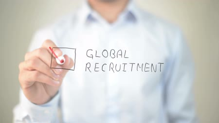 pracodawca : Global Recruitment, Man writing on transparent screen