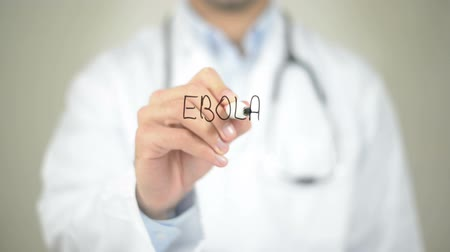 transmit : Ebola, Doctor writing on transparent screen