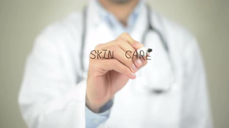 cuidados com a pele : Skin Care, Doctor writing on transparent screen Stock Footage