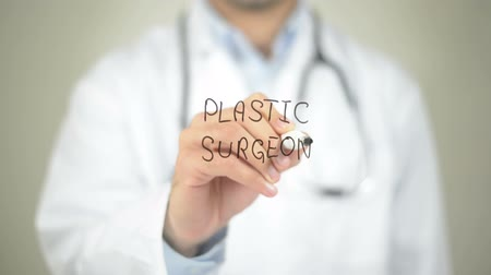 operacja plastyczna : Plastic Surgery, Doctor writing on transparent screen Wideo