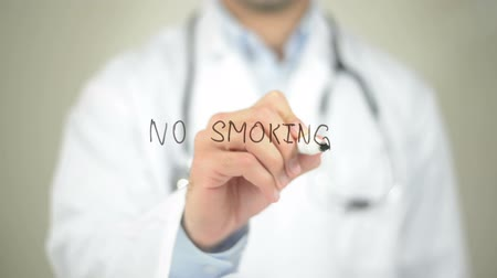 apodrecendo : No Smoking, Doctor writing on transparent screen Stock Footage