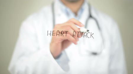 chest pain : Heart Attack, Doctor writing on transparent screen Stock Footage