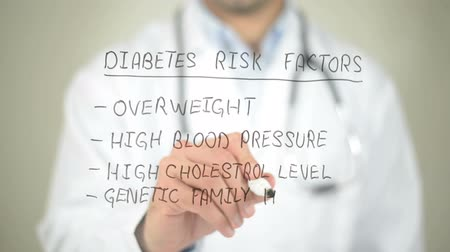 диета : Diabetes Risk Factors, Doctor writing on transparent screen