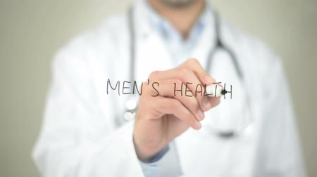 sphygmomanometer : Mens Health, Doctor writing on transparent screen Stock Footage